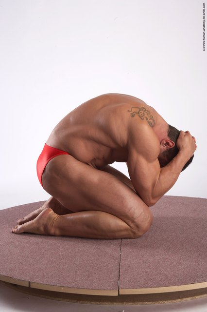 Swimsuit Man White Kneeling poses - ALL Muscular Short Brown Kneeling poses - on both knees