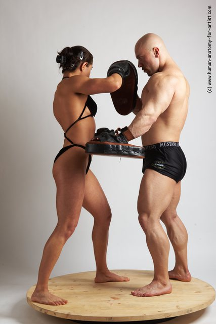 Swimsuit Martial art Woman - Man White Standing poses - ALL Muscular Bald Standing poses - simple