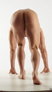 Naked men bent over