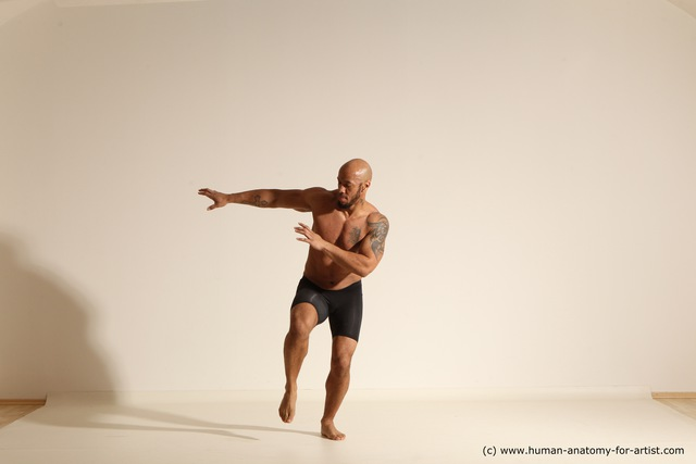 Photo of Underwear Gymnastic poses Man Black Moving poses Muscular Bald Dynamic poses