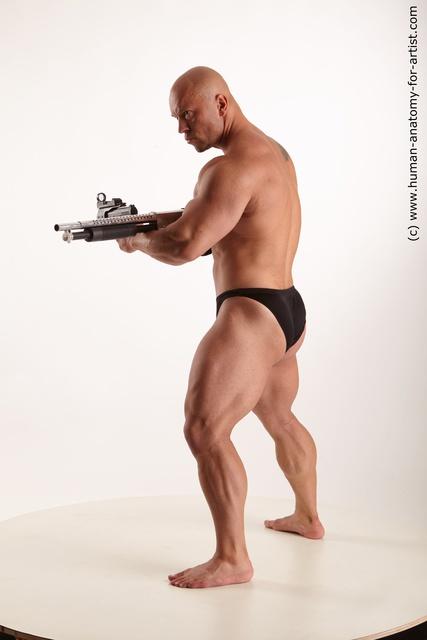 Underwear Fighting with gun Man White Muscular Bald Standard Photoshoot
