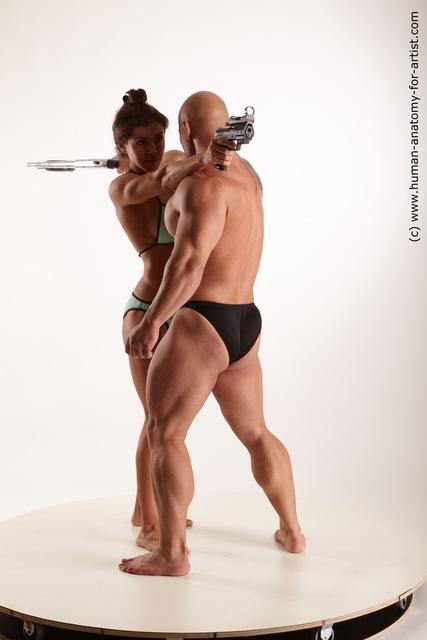 Swimsuit Fighting with gun Woman - Man White Muscular Standard Photoshoot