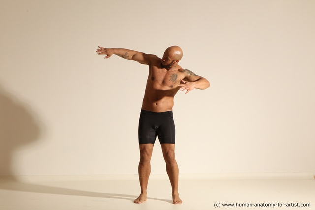 Nude Man Black Muscular Bald Dancing Dynamic poses