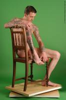 Photo Reference of jan sitting pose 040