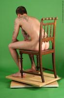 Photo Reference of jan sitting pose 006