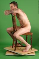 Photo Reference of jan sitting pose 018