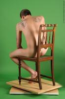 Photo Reference of jan sitting pose 030