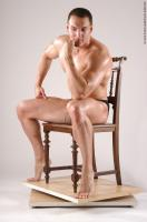 Photo Reference of ivan sitting pose 02