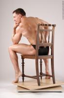 Photo Reference of ivan sitting pose 04