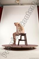 Photo Reference of justin sitting pose 43c