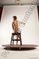 Photo Reference of justin sitting pose 37c