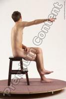 Photo Reference of justin sitting pose 39b