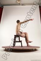 Photo Reference of justin sitting pose 39c