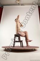 Photo Reference of justin sitting pose 31c