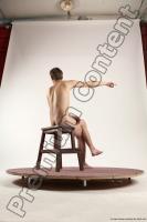 Photo Reference of justin sitting pose 38c