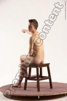 Photo Reference of justin sitting pose 36b